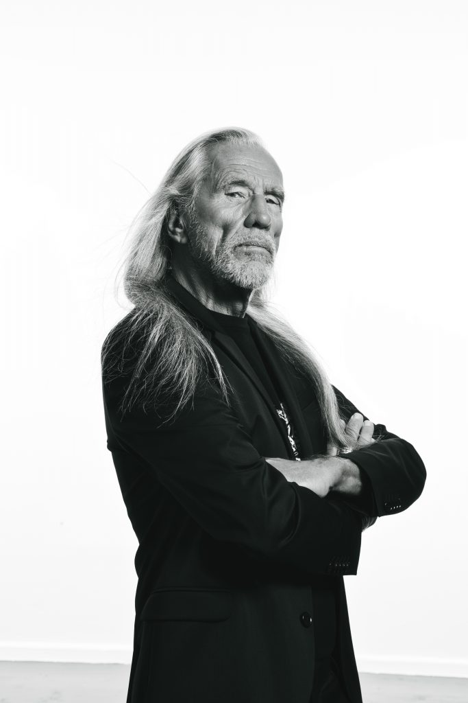 Old man with long hair in black and white