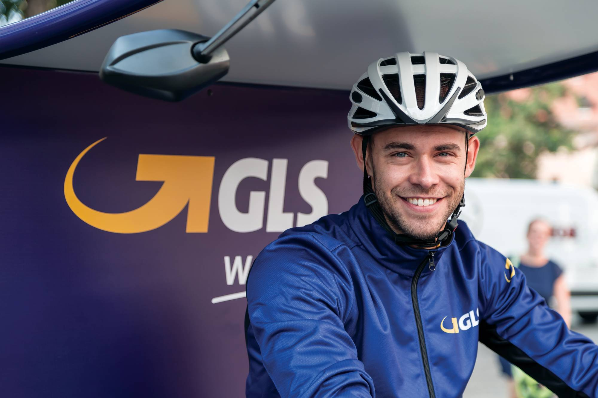 Bicycle delivery courier smiling