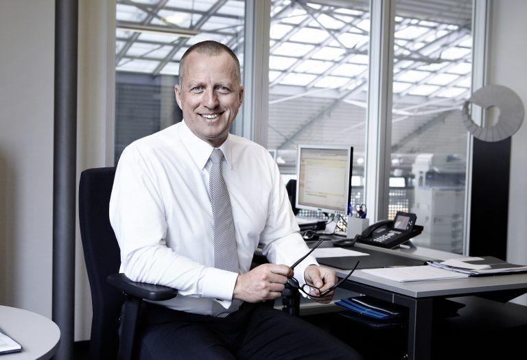 Business executive smiling at desk
