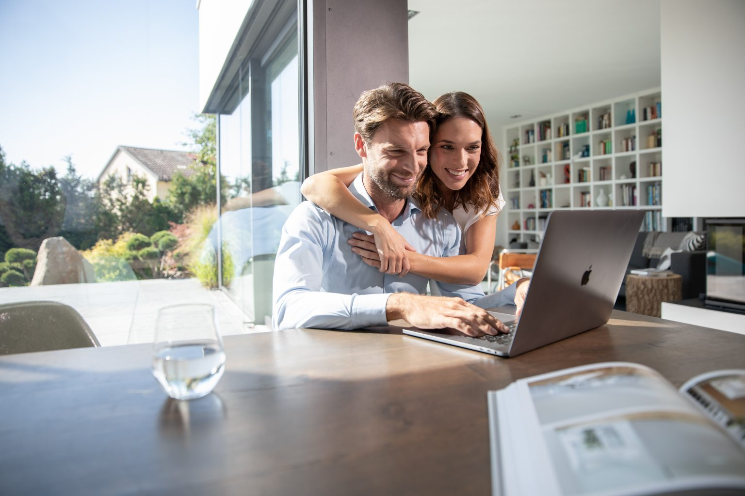 Woman embracing man working from home