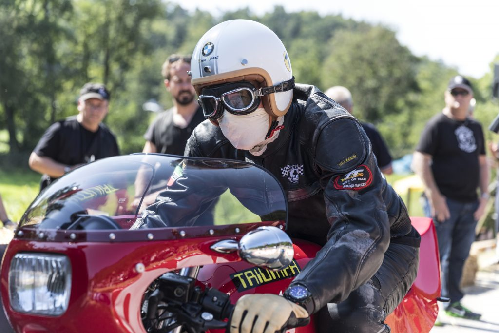 Triumph custom-made motorcycle with rider at race