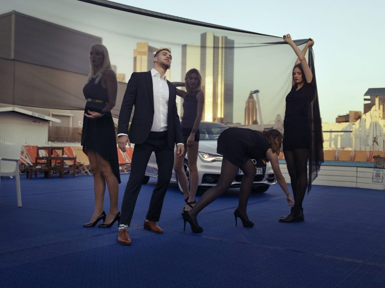 Model partying on rooftop with car